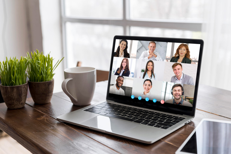 Videocall with 9 persons on a computer over a desktop