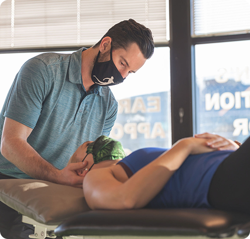 Chiropractor and patient in therapy