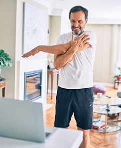 Telehealth stretching man standing up