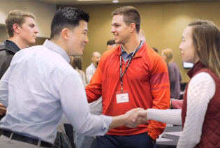 Physical therapists introduce each other at PT Cohort